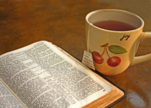 A bible and a coffee cup