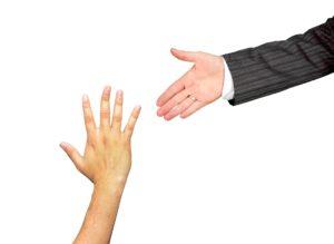 Man reaching helping hand to boy